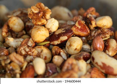 A Nutty, spicy snack. Nuts drizzled with warm spiced honey