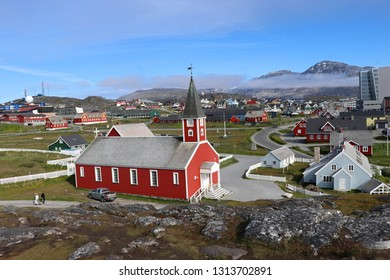 Nuuk Cathedral (Greenlandic: Annaassisitta Oqaluffia) or Church of Our Saviour and  colorful houses in Nuuk,the capital of Greenland, against the backdrop of mountains