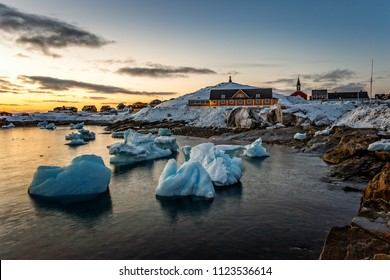 Nuuk city old harbor sunset view with icebergs, Greenland