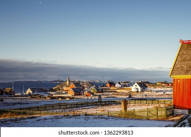 Nuuk city suburb with Inuit houses with sea and the fjord background, Greenland