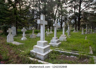 Nuwara Eliya, Sri Lanka - August 6, 2018: Gravestones on the cemetery at the Holy Trinity Church