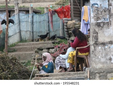 NUWARA ELIYA, SRI LANKA - FEBRUARY 19th: A typical scene of women sitting outside their ramshackle housing of the tea pickers in Nuwara Eliya, Sri Lanka on the 19th February, 2014.