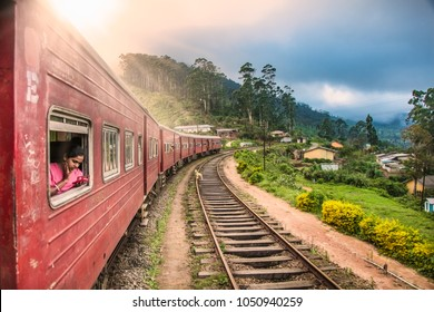 NUWARA ELIYA, SRI LANKA-DEC 29, 2016: Train goes through tea plantation in Nuwara Eliya district on Dec 29, 2016, Sri Lanka. Tea production is one of the main sources of foreign exchange for Sri Lanka