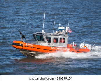 NY - MANHATTAN - 01 JAN 2015: U.S. Coast Guard boat protect Ferry in navigation from Manhattan to Staten Island on Hudson River