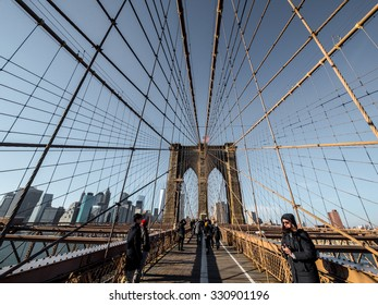 NY - MANHATTAN - 01 JAN 2015: Unidentified people walk on famous Brooklyn Bridge in Manhattan