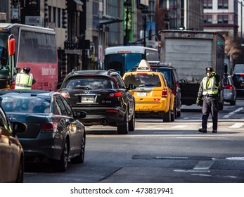 NY - MANHATTAN 01 JAN 2015: Unidentified Policeman directs the traffic in New York City.