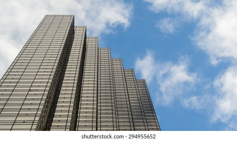 NY - MANHATTAN, 31 DEC 2014: Top of Trump Tower with blue sky and clouds in Manhattan