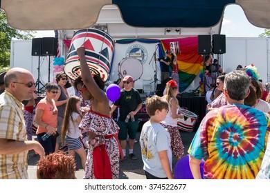 Nyack, NY - June 14 2015: Black girl from Batala NYC band carrying big drum at Rockland Pride festival.