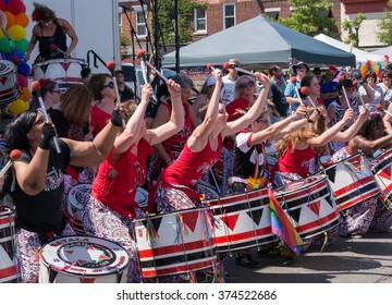 Nyack, NY - June 14 2015: Members of Batala NYC, women only band, performing on and before the stage during Rockland County Pride. At the first line young women express joy and enthusiasm.