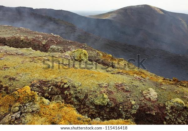 Nyamuragira (Nyamulagira) Volcano, Kimanura Eruption 2011-2012. Yellow sulfur deposits on craters formed during initial stage of eruption.