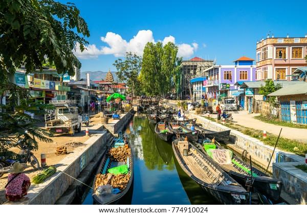 Nyaung Shwe, Myanmar (Burma) - November 2017: Wooden boats on the Inle lake in village Nyaung Shwe. Inle lake is a popular tourist destination of Asia
