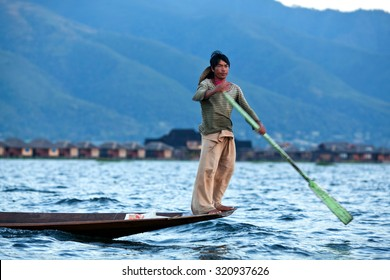 NYAUNG SHWE, MYANMAR - JANUARY 12: Fisherman catches fish for food on January 12, 2012 on Inle Lake, Myanmar. Intha people possess the feet-rowing style and the unique fishing equipment.