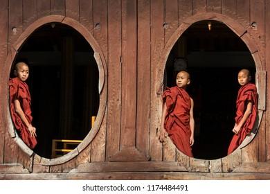 Nyaungshwe. Myanmar. 02.05.13. Young novice monks enjoy the morning sun at Shwe Yaunghwe Kyaung Monastery at Nyaungshwe near Inle Lake in Shan State in central Myanmar (Burma).