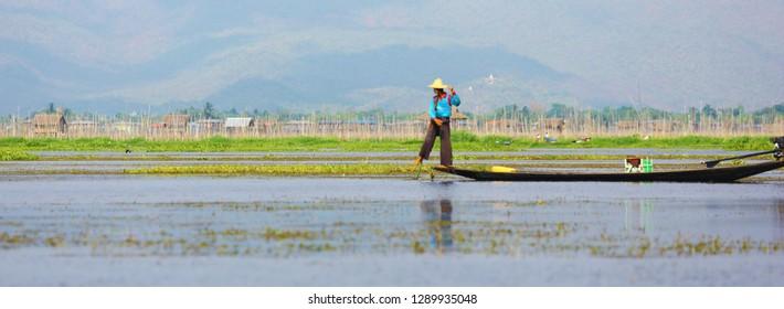 Nyaungshwe, Myanmar - April 24, 2016: Fisherman on lake Inle, Myanmar