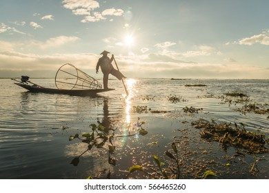 Nyaungshwe, Myanmar - December 18 2016: The silhouette of Intha fisherman of Inle lake, Myanmar. The Intha are the only people in the world to fishing using one leg.