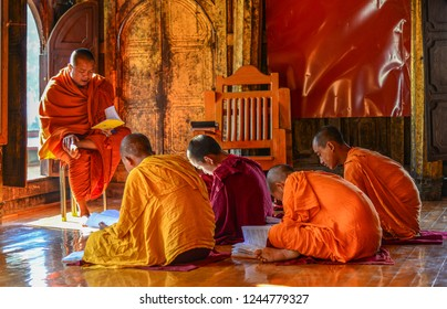 Nyaungshwe, Myanmar - Feb 8, 2017. Young Samaneras (novice monks) sitting and studying in prayer hall of Shwe Yan Pyay Monastery.