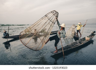NYAUNGSHWE, SHAN STATE, MYANMAR - 2016/16/03: Apart from all acrobatic's that happen's on Inle Lake, the traditional trap fishing technique of the Intha fisherman is still alive.