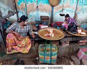 Nyaung-U, Old Bagan, Mandalay Region,  Myanmar.  February 7, 2018. Two Burmese lady's selling fresh Chickens at the local Mani Sithu Market.