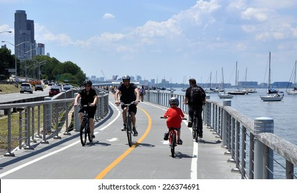 NYC - July 15, 2011:  Bicyclists enjoy a summer afternoon on the Hudson River bike path sandwiched between the Hudson River and the Miller Highway (Router 9) on the west side of Manhattan
