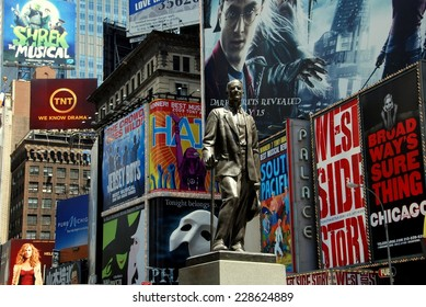 NYC - July 4, 2009: Statue of famed showman George M. Cohan and huge outdoor billboards promoting Broadway musicals in Times Square