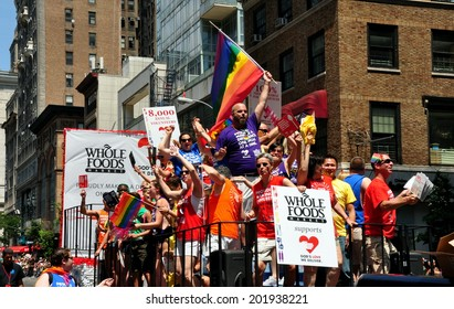 NYC - June 29, 2014:  Riders on the Whole Foods / God's Love We Deliver float at the 2014 Gay Pride Parade on Fifth Avenue