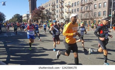 NYC Marathon runners on 4th Ave and 41st Street in Brooklyn, NY.  Nov 4th, 2018.