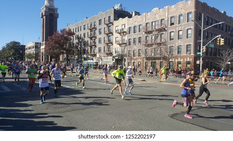 NYC Marathon runners on 4th Ave and 41st Street in Brooklyn, New York.  Nov 4th, 2018.