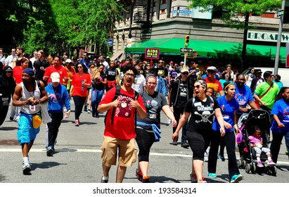 NYC - May 18, 2014:  Some of the 30,000 people participating in the annual AIDS WALK NYC 2014 walkathon to raise money for AIDS charities and research