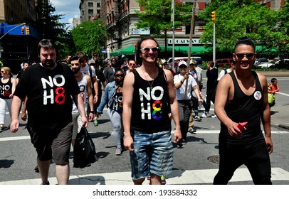 NYC - May 18, 2014:  Two men wearing NO H8 (HATE) tee shirts walking in the annual AIDS WALK NY 2014 event to raise money for AIDS charities