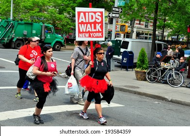 NYC - May 18, 2014:  Two women wearing ballet tutus marching in the annual AIDS WALK NYC 2014 walkathon raising money to fight AIDS