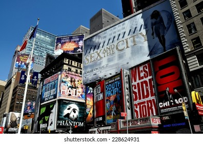 NYC - May 5, 5010:  Advertising covers the sides of buildings promoting Broadway musicals and films in Times Square at West 46th Street