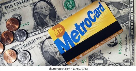 NYC metrocard, dollars - banknotes and coins closeup