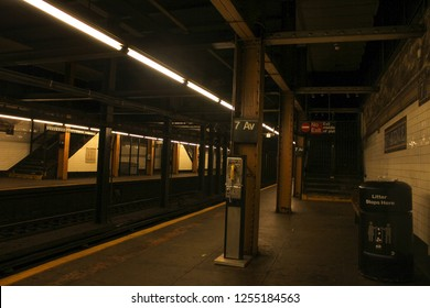 NYC, New York - July 11, 2011: Inside New York city's 7th Ave subway train station platform in low light with dark and haunted mood. NYC old days on 2011.