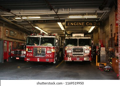 NYC, New York - September 22nd, 2017: F.D.N.Y. firetrucks parked inside a station, being prepped and made ready to go when needed.