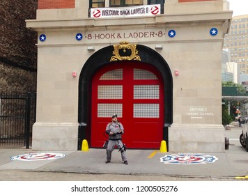 NYC, New York, USA, Oct. 7, 2018- A man dressed as a Ghostbuster poses outside the Hook & Ladder 8 firehouse building where the popular movie was filmed in Tribeca, Manhattan.