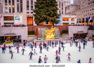 NYC, NY, USA - November 27, 2009: People ice skating at Rockefeller Center in New York City.
