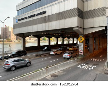 NYC, NY/USA - November 2019 : FDR Drive traffic. Hospital for Special Surgery (HSS) is a hospital in New York City that specializes in orthopedic surgery and the treatment of rheumatologic conditions.