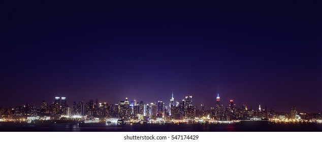 NYC skyline at night.