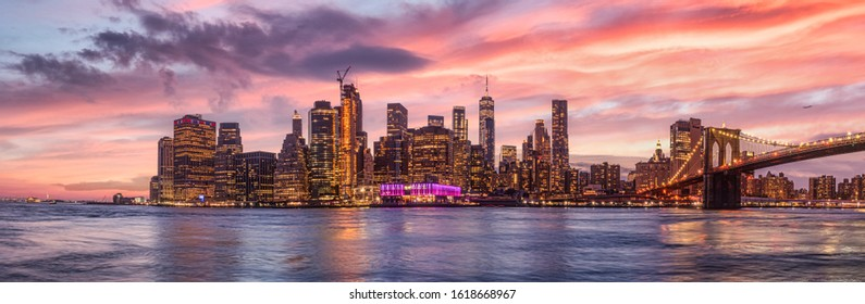 NYC Skyline. Pano New York with dramatic sky. Beautiful sunset manhatten. New York Travel destination. Holiday in newyork. View from Brooklyn. Big Apple red sky. City never sleeps. Skyscraper view.