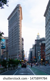 NYC / USA - July 2019: New York City architecture Flatiron building near Madison Square Park in Manhattan. The building is recognised across the world as one of NYC's symbols