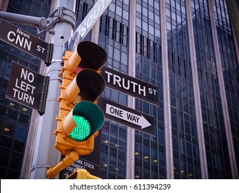 NYC Wall street yellow traffic green light black pointer guide One way to truth. No way, no turn to CNN fake news. Right Choice is truth. Mass media news concept. Politics