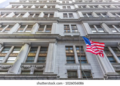 NYC/USA 02 JAN 2018 American flag with building behind. Perspective view.