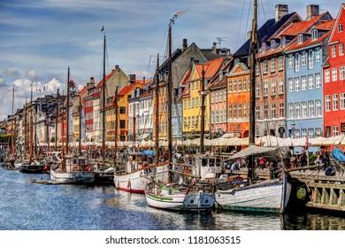 Nyhavn, Copenhagen, Denmark - July 10, 2018: Colourful boats and buildings in Nyhavn, Copenhangen