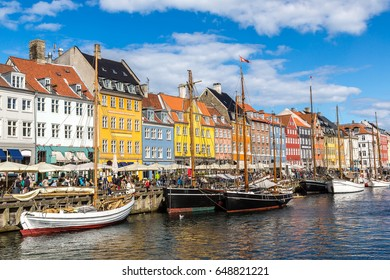 Nyhavn district is one of the most famous and beautiful landmark in Copenhagen, Denmark in a sunny day