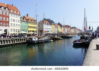 Nyhavn harbour, Copenhagen, Denmark.  Old Town of Copenhagen. Nyhavn district is one of the most famous landmark in Copenhagen. Scenic summer view of color buildings of Nyhavn in Copehnagen