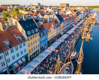 Nyhavn New Harbour canal and entertainment district in Copenhagen, Denmark. The canal harbours many historical wooden ships.