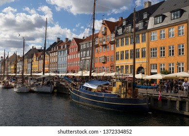 Nyhavn (New Harbour), Copenhagen, Denmark - 23 Jun 2018: it is lined by brightly coloured 17th and early 18th century townhouses and bars, cafes and restaurants.
