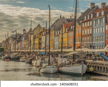 Nyhavn (New Harbour), Copenhagen, Denmark - 4 May 2019: View of Nyhavn pier with color buildings, ships, yachts and other boats in the Old Town of Copenhagen, Denmark, Europe