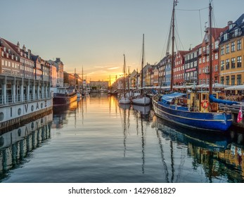 Nyhavn (New Harbour), Copenhagen, Denmark - 14 JMay 2019: Panoramic view of Nyhavn pier with color buildings, ships, yachts and other boats in the Old Town of Copenhagen, Denmark, Europe