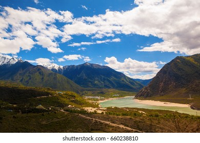 Nyingchi scenery in Qinghai - Tibet Plateau.  Brahmaputra River below the mountain Namjagbarwa. Taken on the Pai Town, Nyingchi, Tibet, China.